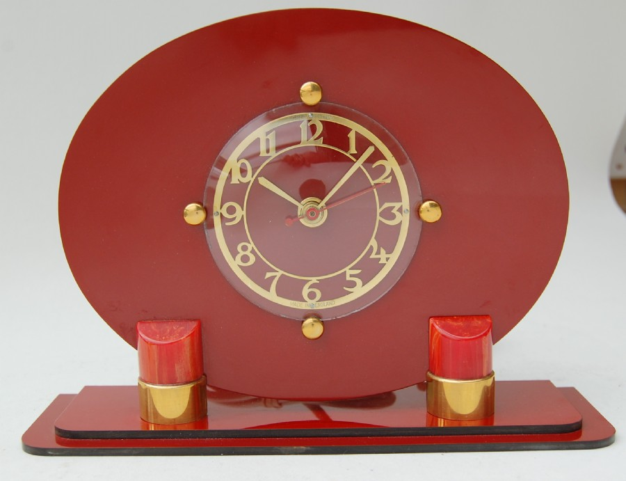 1950 formica, lucite and brass mantle clock. A lipstick clock?