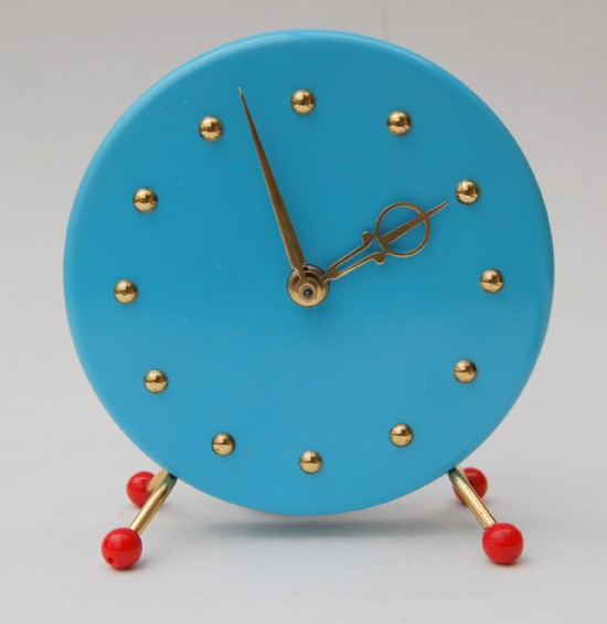 Jakob Palmtag's 1950s happy mantle clock that is delighted to provide you with the time.
