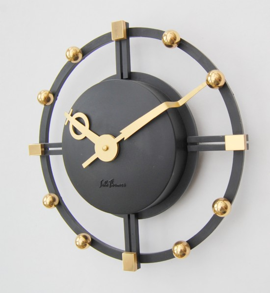 Seth Thomas American 1980s brass and black composite wall clock.