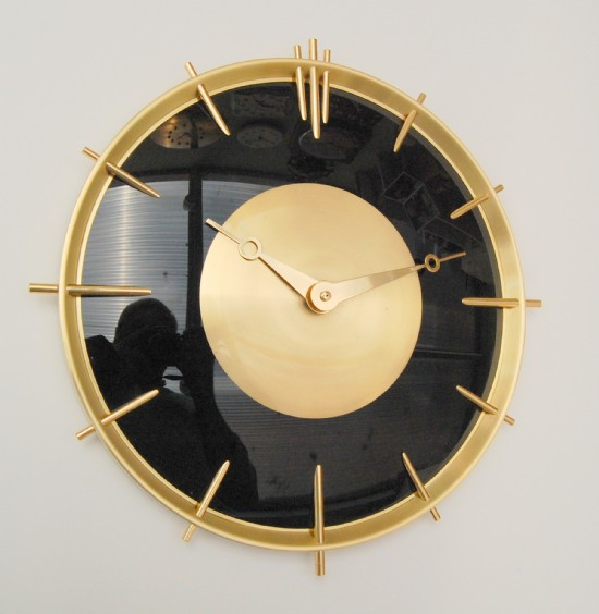 French 1980s machine age clock in brass and black glass