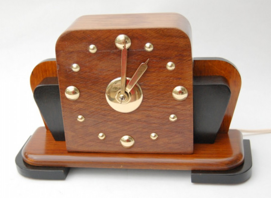 1930s Smiths oak and brass electric clock. Super.